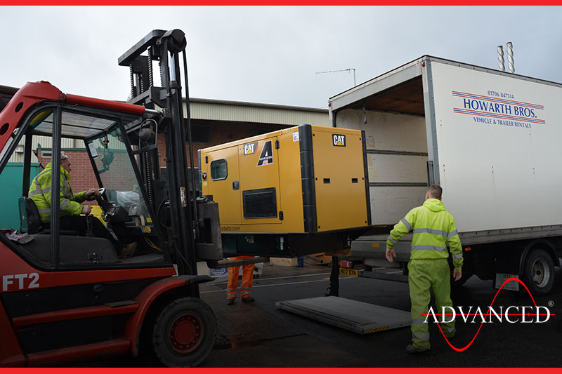 cat genset loaded onto lorry