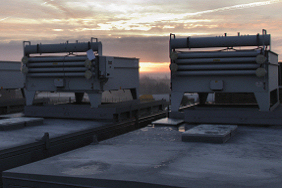 icy roof mounted radiators at sun rise