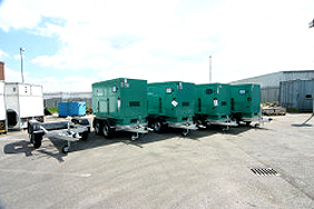 a row of trailer mounted generators