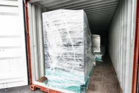 Generators loaded into a brown shipping container are bound for Dubai.