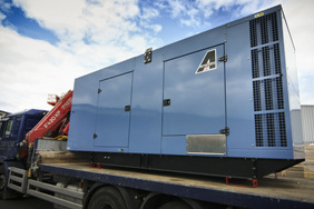 silenced 500kva generator loaded on a flat back lorry