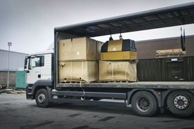 small generator canopies loaded onto a lorry